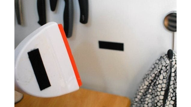Velcro A Dustpan And Brush To a Vertical Surface to Free Up Space