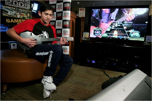 14-year-old Breaks 80 Plastic Guitars To Set Guitar Hero Record