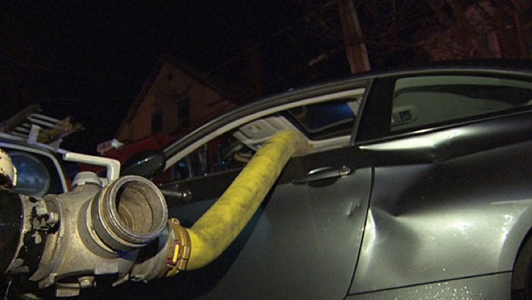 Firefighters Smash 2-Day-Old BMW That Was Illegally Blocking Hydrant