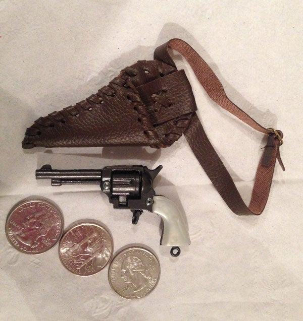 TSA Agent Confiscates Doll's Tiny Toy Gun, Threatens to Call Cops