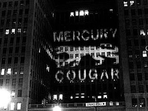 1966: Ford Uses GM Building To Advertise Their Products, GM Chooses Not To Escalate