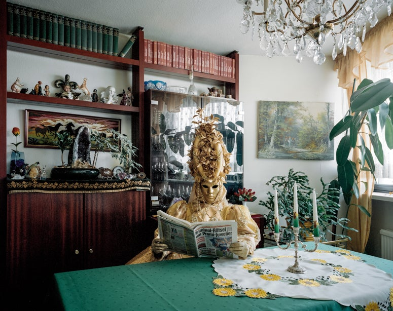 Photographs of cosplayers at home capture both the person and the mask