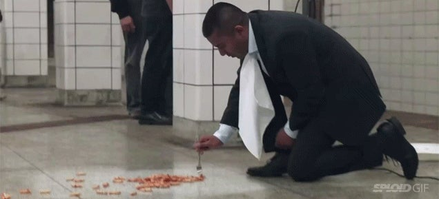 Guy vacuums a subway floor and eats dinner off of it in gross out ad
