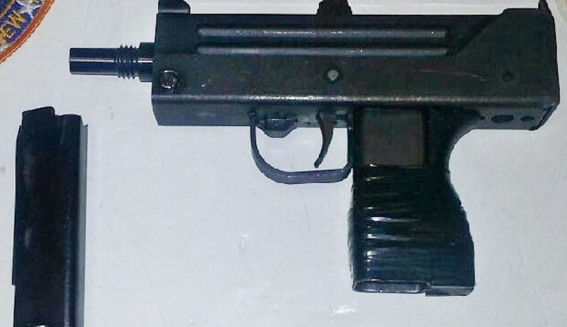 Who Hid a Machine Gun in a JFK Airport Storage Closet Ceiling Panel?
