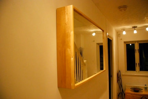 Hide Ugly Door Buzzers with a Hinged Mirror