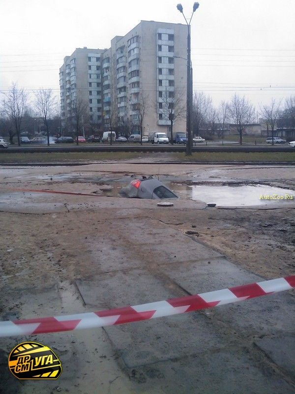 Volkswagen Golf Swallowed By Ukrainian Pothole