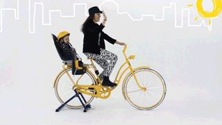 A Brilliant Child's Bike Seat That Instantly Transforms Into a Stroller