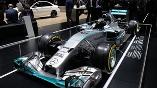 [Auto shows tend to focus on street cars, but Mercedes brought one of their Formula One show cars to Geneva for all to behold, unusably shiny show-car tires and all. Enjoy. Photo credit: Newspress]