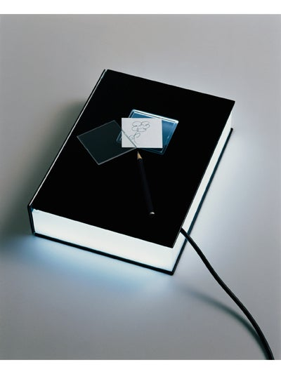 Multibook is a Lamp, Charger and Alarm Clock, Disguised As an Ordinary Book