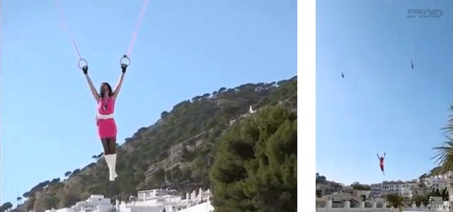 Holy crap, this woman is flying hanging from two toy helicopters!
