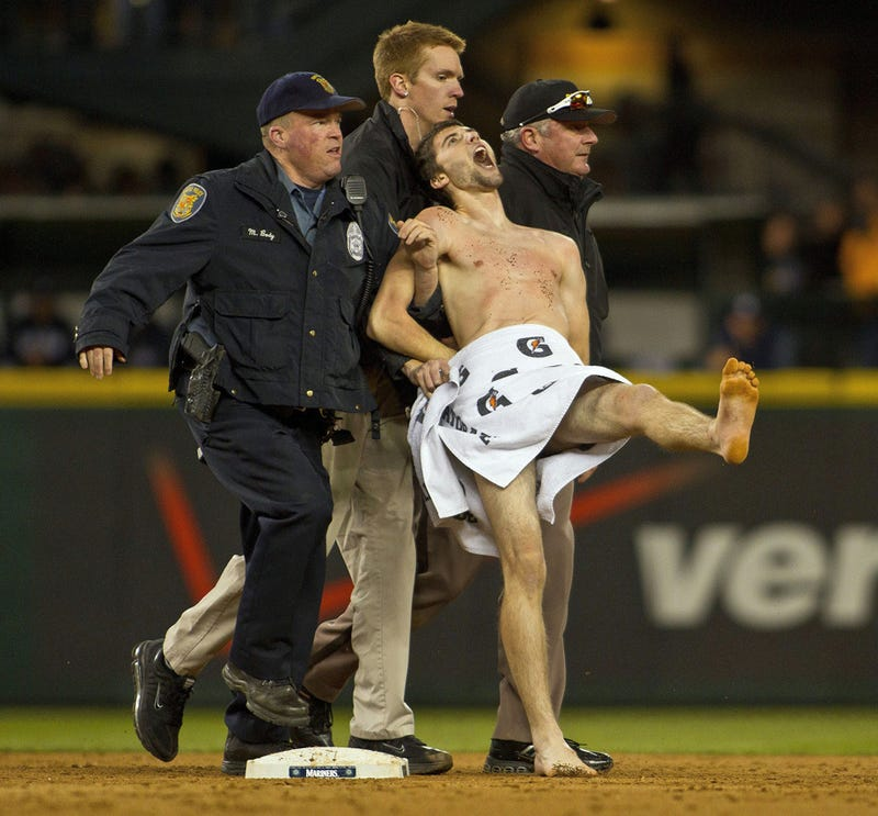 Here's A Photo Of The Seattle Mariners Streaker In The Loving Grasp Of Three Committed Security Guards