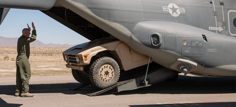 Watch Boeing's Adorable War-Fighting Golf Cart Fit In A Small Aircraft