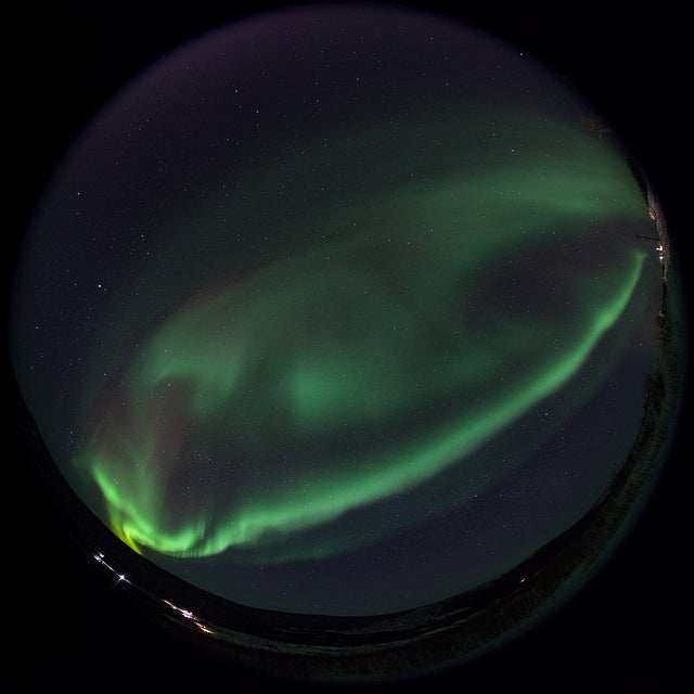A NASA Rocket Soars Into an Emerald Aurora