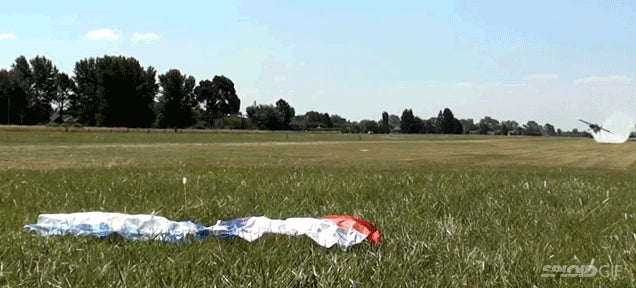 Crazy pilot scoops objects off the ground with his airplane's wing tip