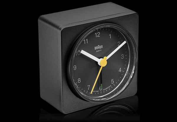 Just Flick This Clock's Simple Face Switch To Activate Its Alarm