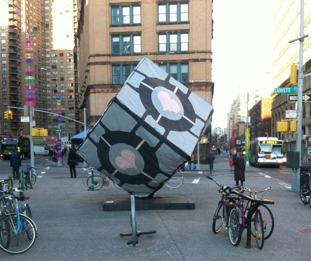 A giant Companion Cube from Portal appears in New York City