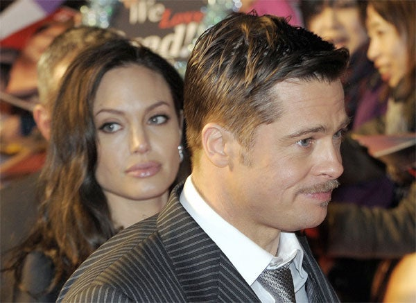 Brad & Angelina's World Tour Is Making Them Weary