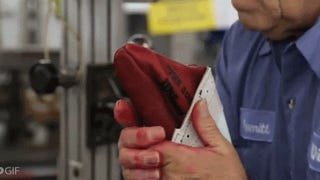 Here's the surprisingly old school way that an NFL football is made