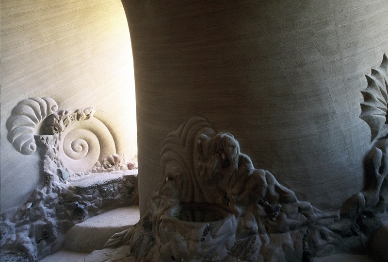 Sculptor carves mythic cathedrals out of New Mexico's sandstone cliffs