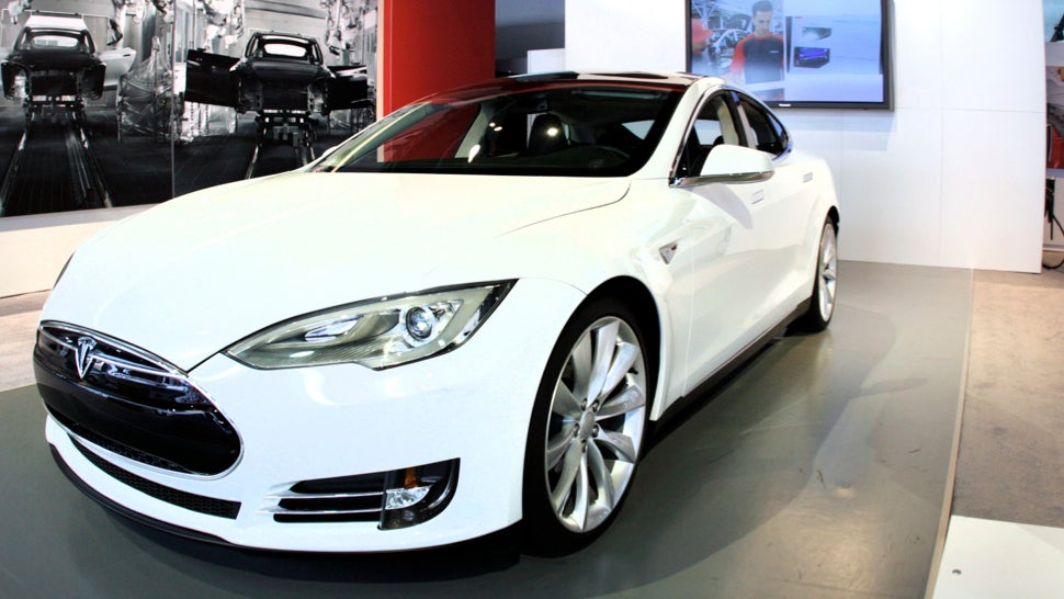 tesla is set to take on snow with an all wheel drive model s. Black Bedroom Furniture Sets. Home Design Ideas