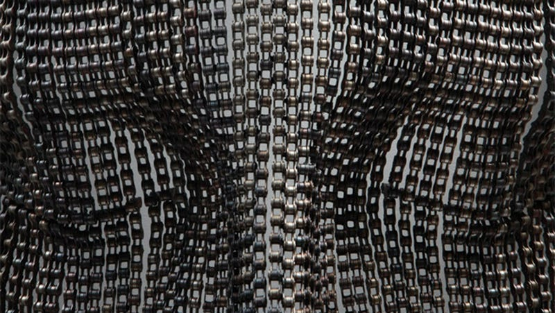 These Giant Meditating Faces Were Made From Bike Chains