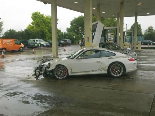 Porsche 911 GT3 RS Stuffed Into Gas Pumps