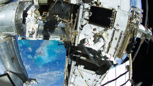 Astronauts repair space station with toothbrush
