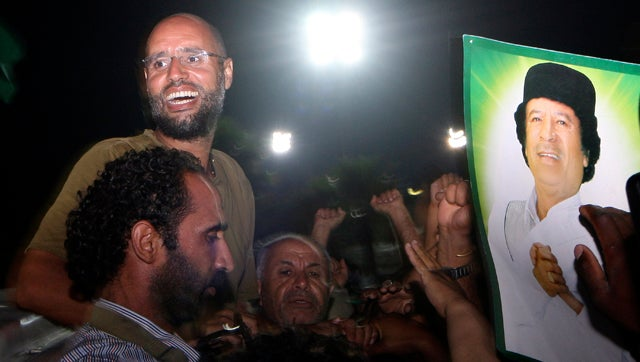 Fugitive Qaddafi Son to World: 'Go to Hell'