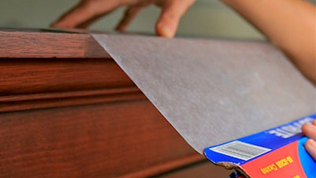 Layer Wax Paper On Top of Hard-to-Reach Shelves to Make Dusting a Breeze