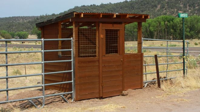 """New Mexico kids wait for the bus inside """"kid cages"""" because... wolves?"""