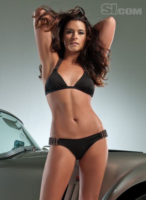 Danica Patrick Straddles A Cobra In New SI Swimsuit Issue