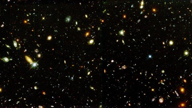 The universe is at least 250 times bigger than it looks