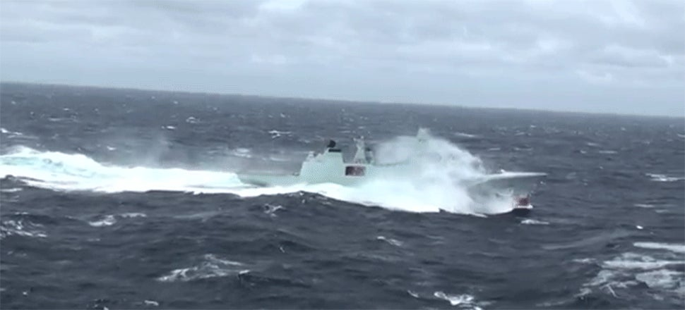 I Can't Stop Watching This Frigate Pound Through Rough Seas