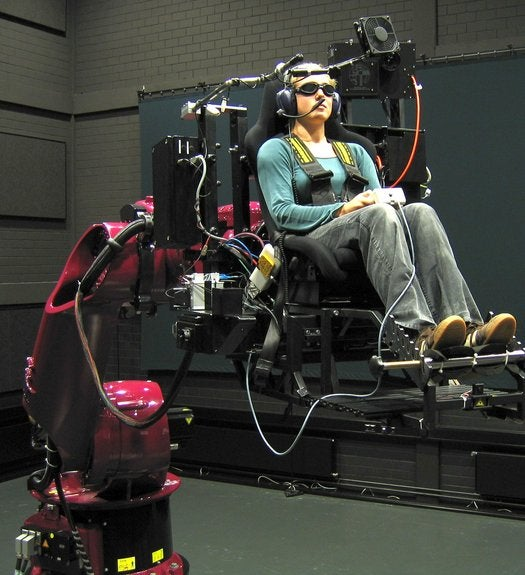Watch a Giant Robot Arm Simulate a Ferrari Test Drive