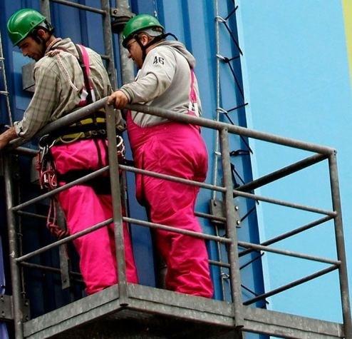 Germans Don Cute Pink Overalls To Festoon Ford Plant With Fiesta Banners