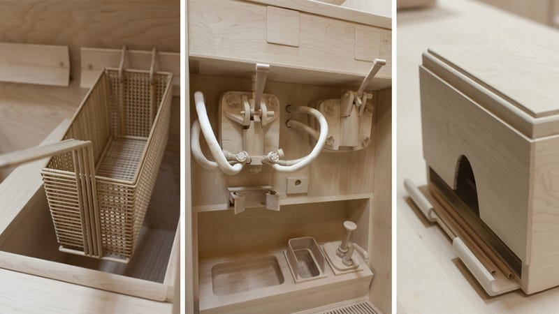Someone made a full scale burger kitchen entirely carved in wood