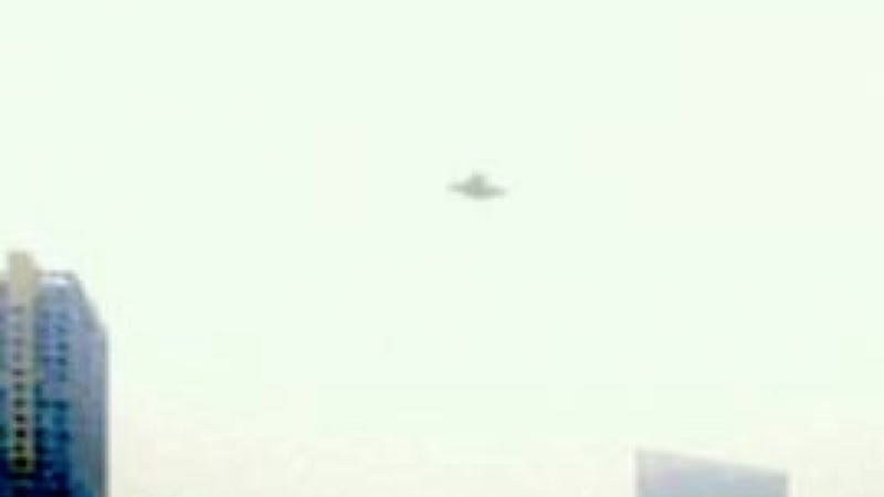 A UFO emerges from the smog over Beijing