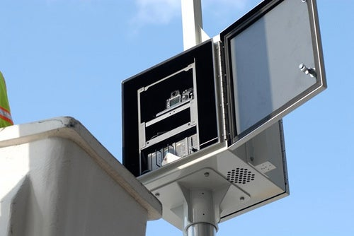 Brooklyn Couple Snags Nikon Traffic Cameras With Cherry Picker