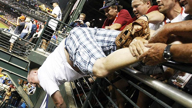 Baseball Fan Narrowly Avoids Death Diving to Catch Ball