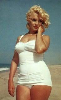 Writer Tries On Marilyn's Wardrobe •Vegetarian Cat Prefers Organic