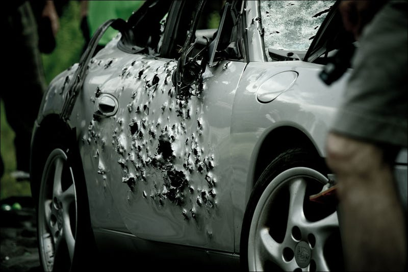 this is a porsche with 10 000 bullet holes. Black Bedroom Furniture Sets. Home Design Ideas