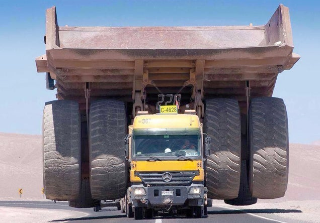This truck transporting a massive mining truck looks like a tiny toy