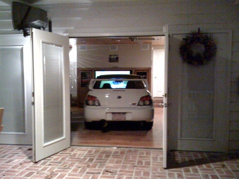 Subaru Fan-Boys Drive Impreza Into Living Room To Watch TV Up-Close