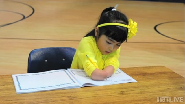 National Penmanship Prize Awarded To Girl With No Hands