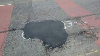 Spraypainting Phalluses On Potholes Is One Way To Get Them Fixed