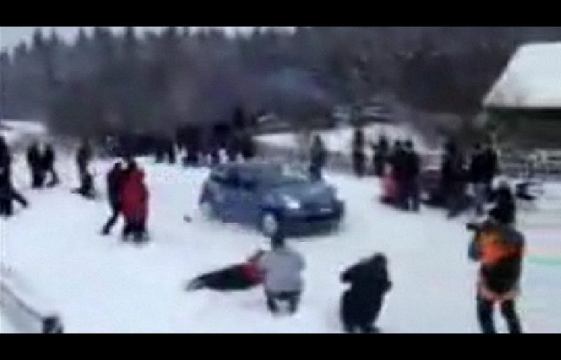 Speeding Rally Car Clips Photographer, Sends Camera Flying