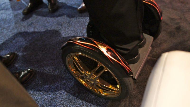 Man on Man Gold-Rimmed Segway CES Monster Love