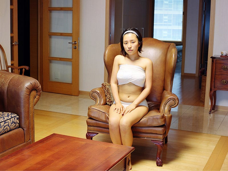 Photos Of Women Hiding After Plastic Surgery Are Disquieting, Poignant