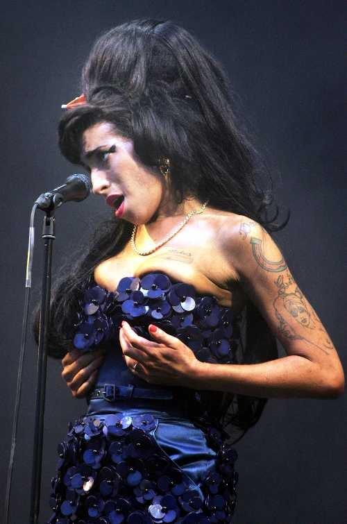 Nelson Mandela Turns 90 • Amy Winehouse Gets Grabby At Glastonbury