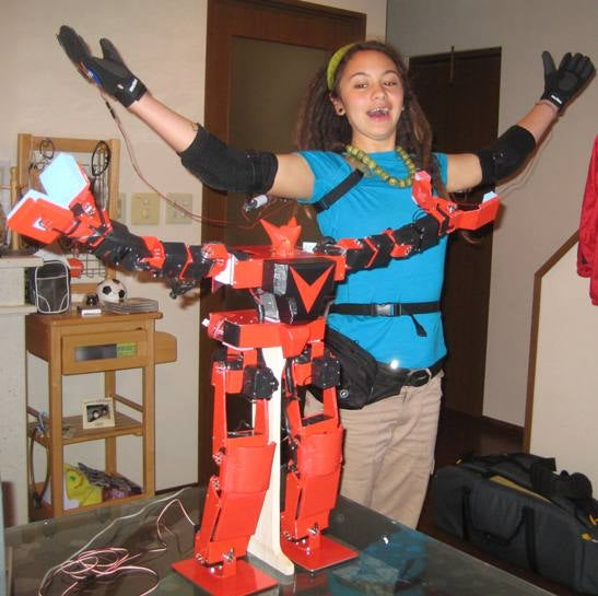 Girl Pilots Japanese Fighting Robot With Gundam Master/Slave Control Suit